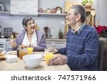 cheerful senior couple having... | Shutterstock . vector #747571966