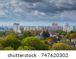 a view of the city in the trees. | Shutterstock . vector #747620302