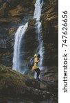 young caucasian female hiker in ... | Shutterstock . vector #747626656