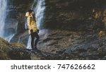 young caucasian female hiker in ... | Shutterstock . vector #747626662