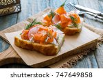 bruschetta with salmon | Shutterstock . vector #747649858