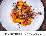 duck leg confit top view | Shutterstock . vector #747667192