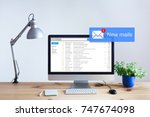 receiving email in inbox... | Shutterstock . vector #747674098