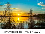 sunset forest lake fog... | Shutterstock . vector #747676132
