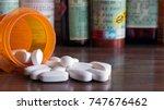 white prescription pills...   Shutterstock . vector #747676462