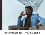 stylish african american man in ... | Shutterstock . vector #747693556