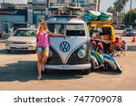 beautiful girl standing by the... | Shutterstock . vector #747709078