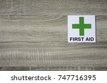 Green First Aid Sign On The...