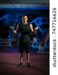 young male athlete bodybuilder... | Shutterstock . vector #747716626