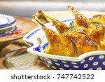 homemade baked quail with honey ... | Shutterstock . vector #747742522