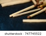 scattered matches on dark... | Shutterstock . vector #747745522