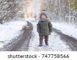 boy in winter forest | Shutterstock . vector #747758566