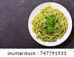 plate of pasta with pesto sauce ... | Shutterstock . vector #747791935