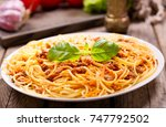 plate of pasta bolognese on a... | Shutterstock . vector #747792502