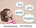 Small photo of Thoughtful young girl with text Do you speak English in the thought bubbles