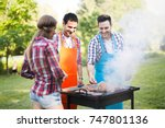 friends having a barbecue party ... | Shutterstock . vector #747801136