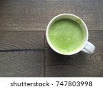 a cup of hot green tea latte on ... | Shutterstock . vector #747803998