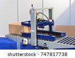 automatic box packing machine... | Shutterstock . vector #747817738