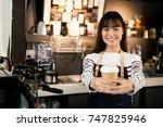 young asian women barista hold... | Shutterstock . vector #747825946