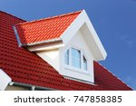 red tiled roof with dormer  | Shutterstock . vector #747858385
