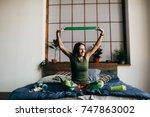 sport girl doing exercises | Shutterstock . vector #747863002