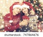 happy couple embrace near...   Shutterstock . vector #747864676