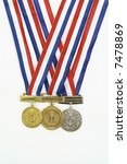 Small photo of medals from various scholastic awards