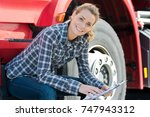 young female driver next to a... | Shutterstock . vector #747943312