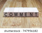 Small photo of Comment Word In Wooden Cube