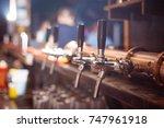 many beer taps in the beer bar | Shutterstock . vector #747961918