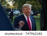 Small photo of President Donald Trump speaks with reporters before departing the White House for an 11-day, 5-nation trip to Asia, Friday, November 3, 2017.