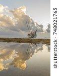 fishing boat shipwreck or... | Shutterstock . vector #748021765