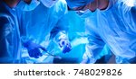 team surgeon at work in... | Shutterstock . vector #748029826