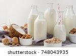 alternative types of milks in... | Shutterstock . vector #748043935