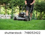 the lawn is mown with the lawn... | Shutterstock . vector #748052422