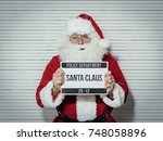santa claus arrested on... | Shutterstock . vector #748058896