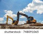 excavator blue sky heavy...   Shutterstock . vector #748091065