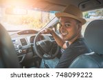 young handsome asian man... | Shutterstock . vector #748099222