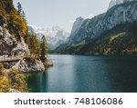 scenic image of great alpine... | Shutterstock . vector #748106086