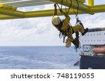 working at height. working... | Shutterstock . vector #748119055