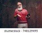 happy senior man communicates...   Shutterstock . vector #748129495