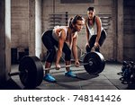 young woman exercising at the... | Shutterstock . vector #748141426
