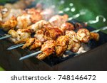 shish kebab from the chicken in ... | Shutterstock . vector #748146472