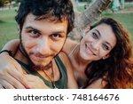 handsome couple taking selfie... | Shutterstock . vector #748164676