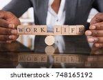 close up of a businesswoman's... | Shutterstock . vector #748165192