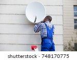 young african man in uniform... | Shutterstock . vector #748170775