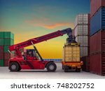 reach stacker is working at... | Shutterstock . vector #748202752