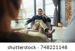 psychologist advicing and... | Shutterstock . vector #748221148