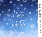 hello winter typographic poster.... | Shutterstock . vector #748241122