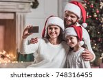 merry christmas and happy new... | Shutterstock . vector #748316455